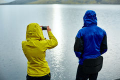 Hikers on the Lake coast with mountain reflection, Iceland Royalty Free Stock Photography