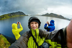 Hikers on the Lake coast with mountain reflection, Iceland Royalty Free Stock Image
