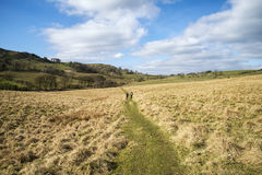 Hikers in landscape in Peak District in UK Royalty Free Stock Photos
