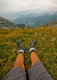 Hikers legs. With view on the mountain Royalty Free Stock Image