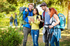 Hikers look at map and compass Royalty Free Stock Photo
