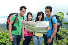 Hikers Looking The Map In Countryside Royalty Free Stock Images
