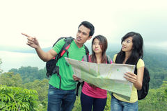 Hikers Looking The Map In Countryside Stock Image