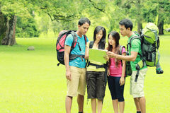 Hikers Looking The Map In Countryside Stock Photography
