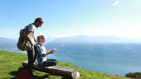 Hikers looking at map on digital tablet stock video