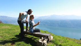 Hikers looking at map on digital tablet stock footage