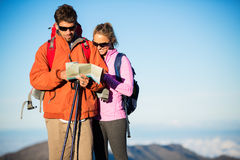 Hikers looking at trail map. Hiking in the mountains Royalty Free Stock Photography
