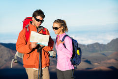 Hikers looking at trail map. Hiking in the mountains Royalty Free Stock Photos