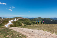 Hikers on the lookout in the beautiful spring mountains Royalty Free Stock Photos