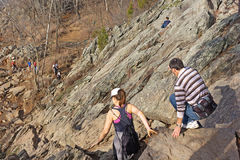 Hikers making their way to the lower section of the rocky Billy Goat trail in the park. Stock Image