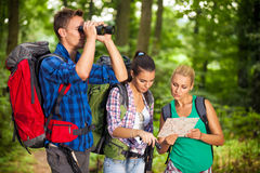 Hikers with map and binocular Stock Images