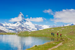 HIkers on the Matterhorn view trail. Swiss Alps Stock Photography