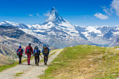HIkers on the Matterhorn view trail. Alps Royalty Free Stock Images