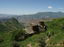 Hikers at Medieval Church Ruins. Hikers arrive at the ruins of the medieval Tsakhats Kar monastery near Artabuynk, Armenia Royalty Free Stock Photos