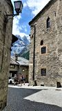 Hikers in Medieval Town in French Alps stock photos