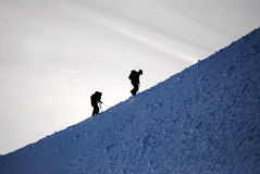 Hikers on mont blanc. Silhouettes of two hikers on mont blanc Royalty Free Stock Photo