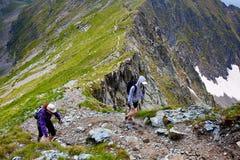 Hikers on mountain Stock Photo