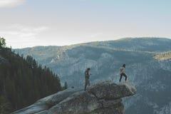 Hikers on mountain ledge