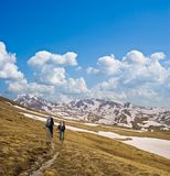 Hikers on a mountain slope Stock Photos