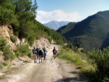 Hikers on a Mountain Track. Group of Hikers on a Mountain Track in Spain Royalty Free Stock Photos