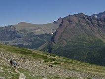 Hikers on Mountain Trail. This image of the hikers on the mountain trail was taken in Glacier National Park of western MT Royalty Free Stock Photography