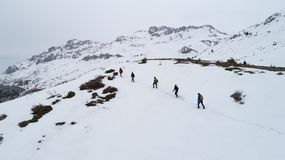 Hikers on mountain in winter stock photography