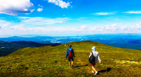 Hikers on Ciucas Mountain Plateau. With green grass at high altitude Stock Photos