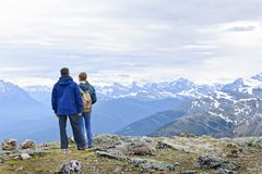 Hikers in mountains stock images