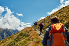 Hikers in the mountains. Hikers with backpacks on the trail in the Apls mountains. Trek near Matterhorn mount Stock Photography