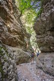 Hikers in a narrow trail of Imbros gorge, Crete Greece. Hikers in a narrow trail of Imbros gorge, Crete, Greece Stock Photography