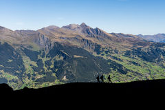 Hikers near the Eiger in Switserland Stock Images