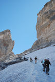 Hikers near the Rolando's gap in Pyrenees. Royalty Free Stock Image