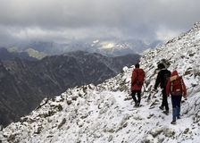 Hikers in new snow,. Crossing a pass in the  High TatrasCzechoslovakia, now Slovakia Royalty Free Stock Photos