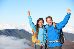 Hikers - people hiking cheering on summit top. With view on volcano. Hiker couple looking at beautiful landscape of mountain volcanoes, Haleakala national park Royalty Free Stock Photos