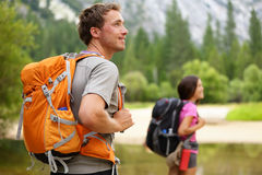 Hikers - people hiking, man looking in Yosemite stock image