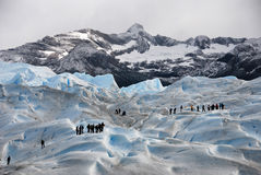 Hikers on Perito Merino Glacier in Patagonia Stock Photos