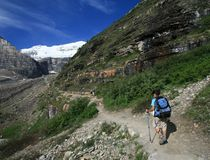 Hikers on Plain of Six Glaciers Trail Stock Images