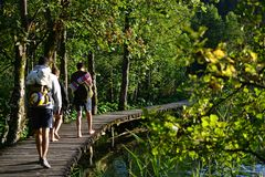 Hikers at Plitvice Lakes National Park, turquoise lakes and waterfalls in Croatia - UNESCO World Heritage. Plitvice Lakes National Park - UNESCO World Heritage stock photography