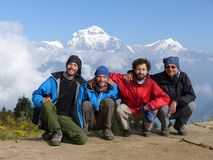 Hikers on Poon Hill, Dhaulagiri range, Nepal. Happy hikers on Poon Hill, Dhaulagiri range on the backround - one of the most visited Himalayan view points in royalty free stock image