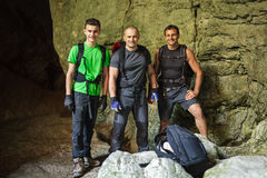 Hikers posing inside a cave Royalty Free Stock Photography