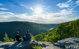 Hikers on Raven Rock in Coopers Rock State Forest WV royalty free stock photos
