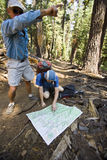 Hikers reading map. Two hikers consult their map along the trail in Yosemite National Park, California on a summer afternoon Stock Photo