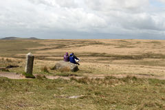 Hikers reading a paper map on dartmoor Royalty Free Stock Photography