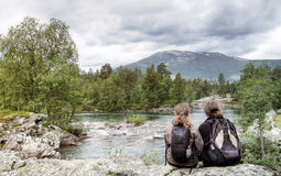 Hikers relaxing by lake Royalty Free Stock Images