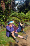 Hikers rest at The Side of Heaphy Track, New Zealand Royalty Free Stock Image
