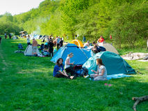 Hikers rest in a tent camp. CRIMEA, UKRAINE - APRIL 29: Unidentified hikers rest in a tent camp on April 29, 2012 in Crimea Mountains, Ukraine. This place is royalty free stock image