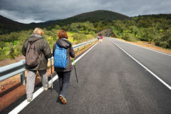 Hikers on the road, Sierra de Aracena Natural Park, Spain Royalty Free Stock Image