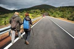 Hikers on the road, Sierra de Aracena Natural Park, Spain Royalty Free Stock Image