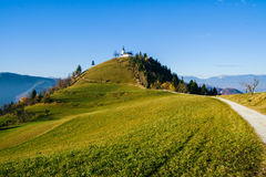 Hikers on the road to the church of St. Jakob. On Petelinec hill near Medvode Royalty Free Stock Photography