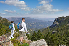 Hikers on a rock in the National Park in Portugal Royalty Free Stock Photos